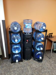 image of water cooler and water storage shelves